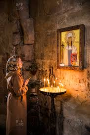 Tbilisi - September 28, 2015: A woman praying in an Orthodox church outside  Tbilisi, Georgia stock photo - OFFSET