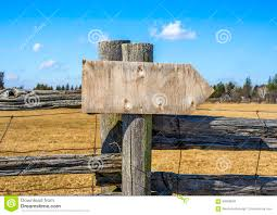 Wooden Arrow Sign Board On Rustic Fence Post In Outdoor Background Ready For Text Stock Photo Image Of Cheerful Fence 89099664