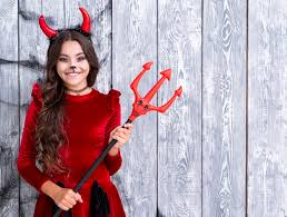 young dressed in devil costume