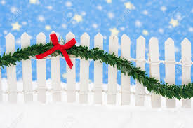 White Picket Fence With Green Garland And Red Bow Merry Christmas Stock Photo Picture And Royalty Free Image Image 3619403