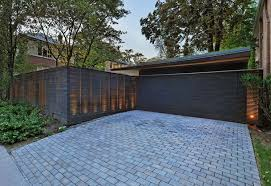 Design Workshop The Many Ways To Conceal A Garage Modern Fence Design Garage Door Design Fence Design
