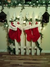 Took A Old Wooden Fence And Turned It Into A Stocking Holder Christmas Stocking Hangers Christmas Signs Wood Christmas Stocking Holders
