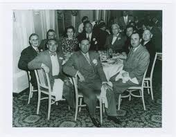 Copy Photograph of Benjamin Siegelbaum alias Bugsy Siegel, Wendy Barrie and  French Lich Seated with Group at Table Date unknown | Lloyd Sealy Library  Digital Collections | John Jay College of Criminal Justice