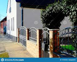 Decorative Wrought Iron Fence With Deep Green Ivy Arch Stock Photo Image Of Fence Iron 174130532