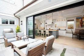 folding glass kitchen doors open to a