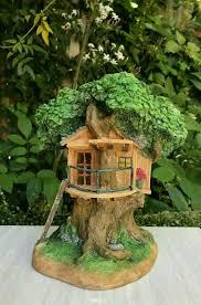 logan gnome on tree stump solar light