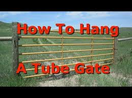 How To Hang A Tube Gate On Round Fence Posts Youtube