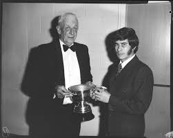 Film negative: League Player of the Year, dinner. Ivan Ryan-Rupene  receiving the trophy. - Canterbury Museum