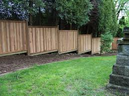 Building A Fence On Sloped Ground Sloped Yard Sloped Backyard Building A Fence