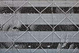 Expressive Portrait Using 55 000 Plastic Discs On Chain Link Fence Wave Avenue