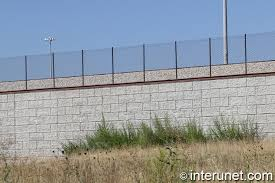 Chain Link Fence On Top Of Concrete Blocks Wall Interunet