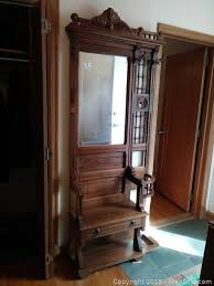 wood antique hall tree with coat hooks