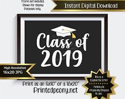 graduation signs and green