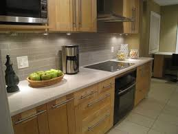 a wall oven under a cooktop