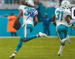 Autographed Walt Aikens 8x10 Miami Dolphins Photo at Amazon's Sports  Collectibles Store