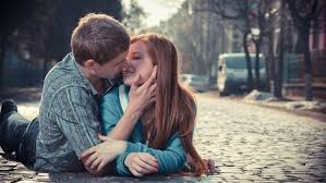 romantic couple kissing street