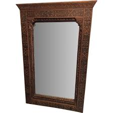 oriental mirror with carved wood frame