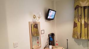 mirror and flat screen tv trouser press