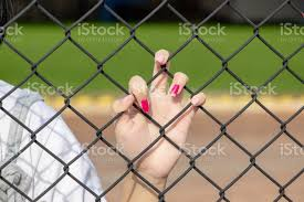 Girl Hand With Peeled Pink Nail Color Holding On Chain Link Fence Stock Photo Download Image Now Istock