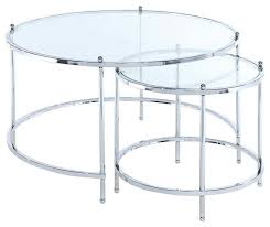 round nesting table in clear and chrome