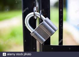 The Castle Locks The Gate A Metal Lock Weighs On A Fence Reliable Property Protection Reinforced Knee Steel Mount Guard Your Home Obstacle For St Stock Photo Alamy