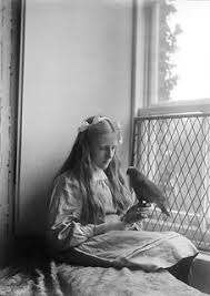 Hilda Young with a parrot c.1898-1900 | Creator: Mary Alice … | Flickr