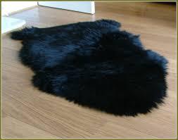 black sheepskin rug natural black