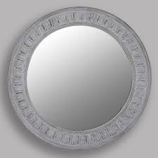 large round mirror with pattern frame