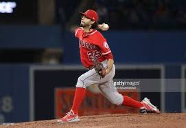 Noe Ramirez of the Los Angeles Angels of Anaheim delivers a pitch ...