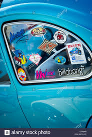 Surfing Life Style Window Stickers On An Old Vw Beetle Car Stock Photo Alamy