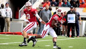 File:Joel Stave hand off to James White.jpg - Wikimedia Commons