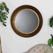 large round gold hammered rim wall