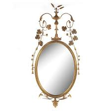 gold decorative oval wall mirror