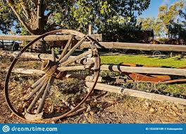 Wagon Wheel Against Wooden Fence Stock Image Image Of Circle Country 153420189
