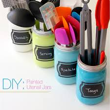 drawer clutter with painted utensil jars