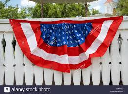 Red White And Blue American Flag Bunting Put Out On White Fence For Stock Photo Alamy