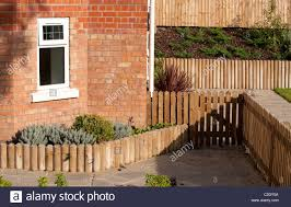 Wooden Gate Fence And Edging In A Newly Landscaped Garden Outside A Stock Photo Alamy