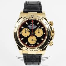 yellow gold case black paul newman dial