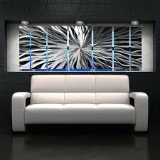 bedroom with metal wall art