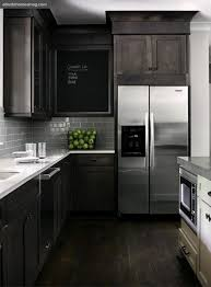 subway tile stained kitchen cabinets
