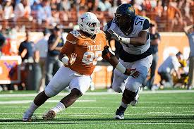 DT Poona Ford (With images) | Texas football, Football helmets, West  virginia