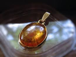 golden amber cabochon 30x20mm pendant