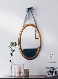 tips on how high to hang a mirror