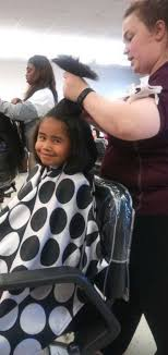6 year old boy grows out his hair for 2