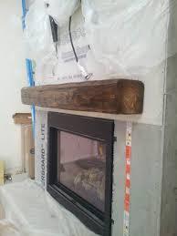 installing a barn beam mantel before