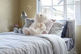 Kids Room With Dolls And Pillows On Bed And Bedside Table Lamp Stock Photo Picture And Royalty Free Image Image 44191809