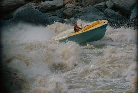 Jon Hamilton Steering a Plunging Jet Boat 'Wee Yellow' up Lava Falls -  Colorado Plateau Digital Archives - Digital Collections