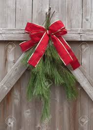 Christmas Greens Tied With Red Ribbon On A Rustic Wood Fence Stock Photo Picture And Royalty Free Image Image 11538073