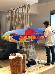 Austin Finley, local artist, painting a surfboard (With images) | Decor,  Home decor, Local artists