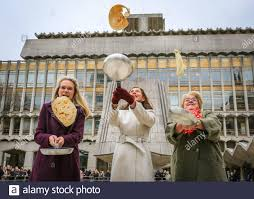 Guildhall, London, UK. 25th Feb, 2020. The Lady Mayoress, Hilary Russell  (middle), wife of current Lord Mayor of the City of London, William  Russell, tosses a pancake to start the event. Shrove
